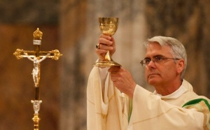 ARCHBISHOP COAKLEY ELEVATES CHALICE DURING MASS AT BASILICA OF ST. PAUL OUTSIDE THE WALLS IN ROME