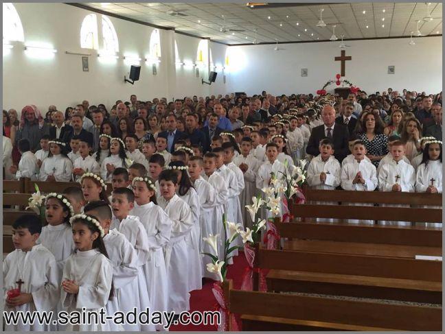 Iraq, nonostante l'Isis, la Chiesa festeggia la prima comunione di cento bambini, nella festa dell'Assunta